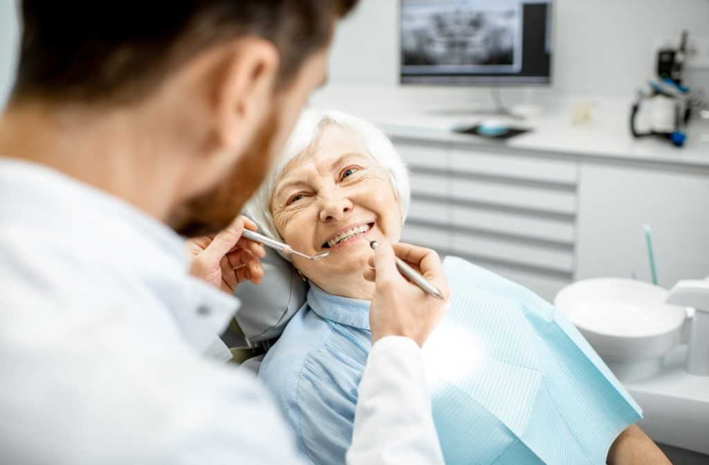 An older woman feeling comfortable and relaxed during her regular dental exam